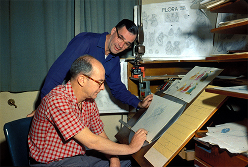 Frank Thomas and Ollie Johnston working at animation desk; courtesy of the Walt Disney Archives Photo Library, © Disney.