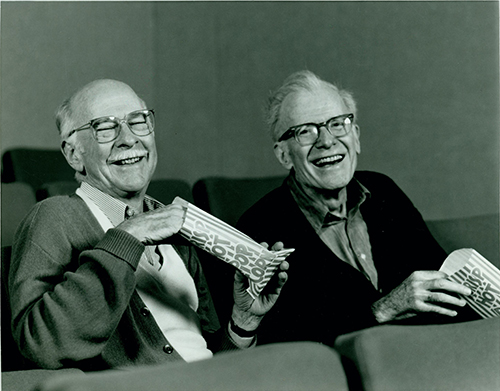 Ollie Johnston and Frank Thomas in theater eating popcorn, 1989; collection of Ollie Johnston.