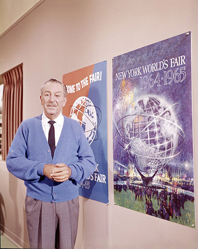 Walt Disney with 1964/65 New York's World Fair poster, ca. 1964; courtesy of the Walt Disney Archives Photo Library, © Disney.