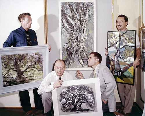 "Joshua Meador, Marc Davis, Eyvind Earle, and Walt Peregoy display their paintings for the ""4 Artists Paint 1 Tree"" segment of the ""An Adventure in Art"" episode of the ""Disneyland"" television series (1958); courtesy of the Walt Disney Archives Photo Librar"