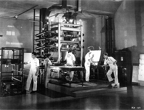 Technicians demonstrate the Multiplane Camera during humorist Robert Benchley's tour of The Walt Disney Studios in The Reluctant Dragon, 1941.