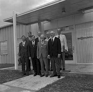 Chairman of the Board, Roy O. Disney, stands behind members of the Board of Directors of Walt Disney Productions, on site in Florida, ca. 1969. Back row (left to right): Card Walker, George L. Bagnall, Roy, Gordon E. Youngman.  Front row (left to right):