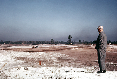 Roy views acreage in Orlando, c. 1969.  Courtesy of the Walt Disney Archives Photo Library, © Disney.
