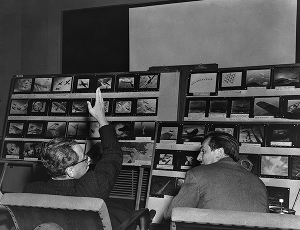 Walt Disney and Alexander P. de Seversky review storyboards for Victory Through Air Power, c. 1942; Courtesy of the Walt Disney Archives Photo Library, © Disney.
