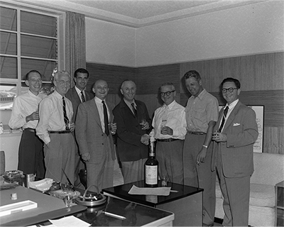 Founding of the Buena Vista Distribution Company. Merrymakers (left to right): Ray Keller, Ned Clarke, Card Walker, Irving Ludwig, Roy, Leo Samuels, Larry Tryon, Paul Pease, c. 1952; Courtesy of the Walt Disney Archives Photo Library, © Disney.