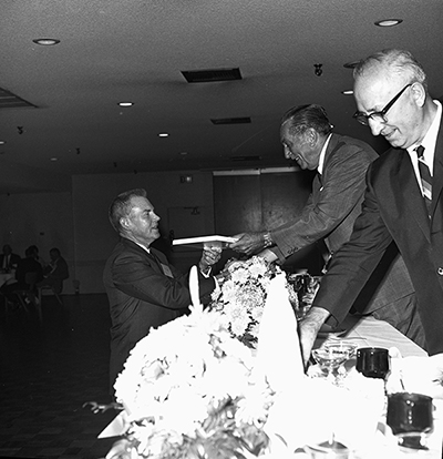 Roy Disney and Walt awarding a plaque to Earl Vilmer, general superintendent of maintenance, c. 1965;  Courtesy of the Walt Disney Archives Photo Library, © Disney.