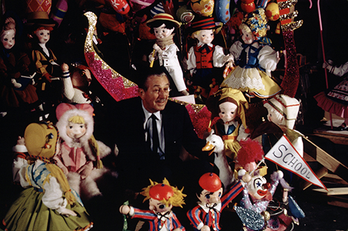 "Walt Disney with ""it's a small world"" Audio-Animatronics® figures, c. 1964; courtesy of the Walt Disney Archives Photo Library, © Disney."