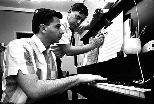 Richard (left) and Robert (right) at the piano working on music for The Ugly Dachshund, ca. 1965; courtesy of the Walt Disney Archives Photo Library, © Disney.