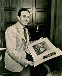 Walt Disney with Snow White and the Seven Dwarfs publicity photos, c. 1941; collection of Ward Kimball, © Disney.