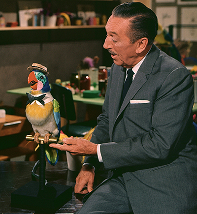 Walt with an Audio-Animatronics Barker Bird. Courtesy of the Walt Disney Archives Photo Library, © Disney