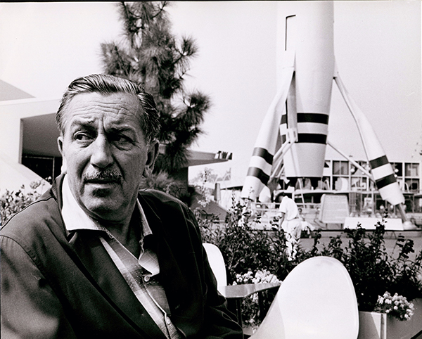 Walt Disney near <em>Rocket to the Moon</em> in Disneyland; c. 1963; collection of the Walt Disney Family Foundation. © Disney.
