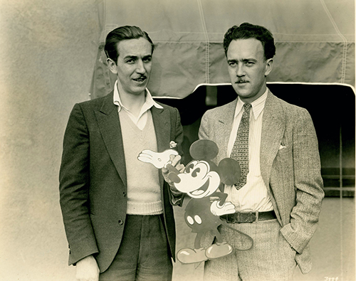Walt Disney and Ub Iwerks holding Mickey Mouse; collection of the Walt Disney Family Foundation, ©Disney.